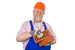 Bricklayer with bricks Stock Images