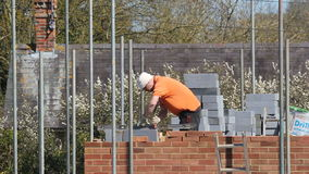 Bricklayer building a new house. stock footage