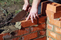 Bricklayer building wall Royalty Free Stock Photo