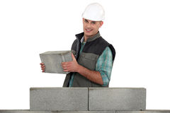 Bricklayer building a wall Stock Photo