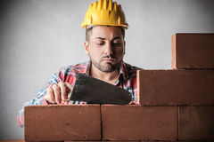 Bricklayer building a wall Stock Photos