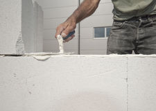Bricklayer builds the wall Royalty Free Stock Images