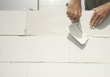 Bricklayer builds the wall Stock Image