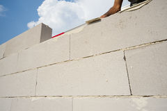 Bricklayer builds the wall Royalty Free Stock Photography