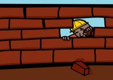 Bricklayer Closing Wall. Bricklayer peeking through hole in brick wall Royalty Free Stock Image