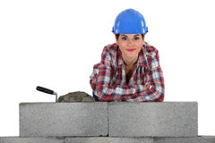 Bricklayer by a concrete wall Royalty Free Stock Photos