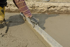 Bricklayer on construction site with straightedge - concrete Royalty Free Stock Photography