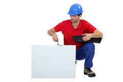 Bricklayer cwith blank message board stock images