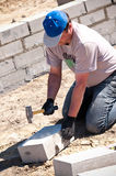 Bricklayer with hammer Royalty Free Stock Photo