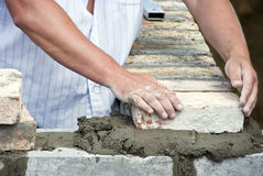 Bricklayer hands closeup Stock Image