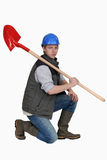 Bricklayer holding shovel Royalty Free Stock Images