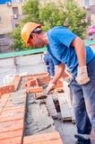 Bricklayer on house construction Royalty Free Stock Image