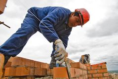 Bricklayer on house construction Stock Image