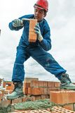 Bricklayer on house construction Stock Photos