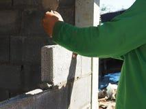 Bricklayer laying bricks to make a wall. Royalty Free Stock Photos