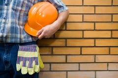 Bricklayer(mason) and bricks royalty free stock photography