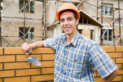 Bricklayer(mason) and bricks Stock Images