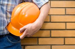 Bricklayer-mason and bricks wall Royalty Free Stock Image