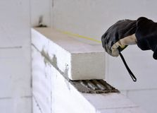 Bricklayer using a tape measure Stock Images