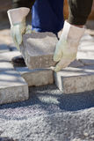 Bricklayer paving a street Stock Images