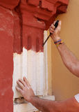 Bricklayer performing the cleaning of the stone facade of a baroque church Royalty Free Stock Photo