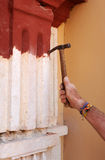 Bricklayer performing the cleaning of the stone facade of a baroque church Royalty Free Stock Photography