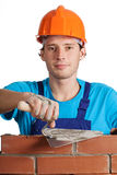 Bricklayer with putty knife Royalty Free Stock Photography