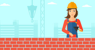 Bricklayer with spatula and brick. Stock Image