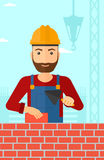 Bricklayer with spatula and brick. Royalty Free Stock Photo