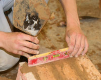 Bricklayer with spirit level Stock Photography