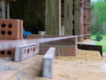 Bricklayer Standard - String taunt and level ensures quality Royalty Free Stock Images