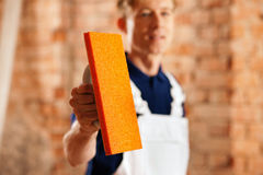 Bricklayer with tool Royalty Free Stock Image