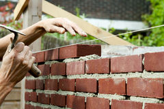 Bricklayer with trowel Stock Photo