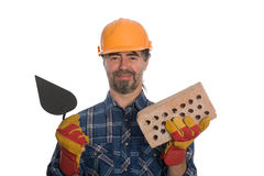 Bricklayer with trowel and brick. Royalty Free Stock Image