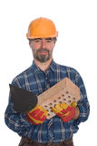 Bricklayer with trowel and brick Stock Photography