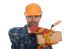 Bricklayer with trowel and brick. Royalty Free Stock Photography