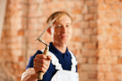 Bricklayer with trowel on construction site Royalty Free Stock Images