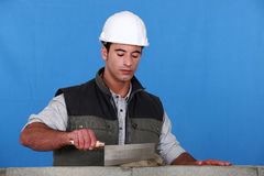 Bricklayer using trowel Stock Photos