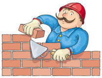 Bricklayer At the Work. Mustachioed bricklayer builds a red brick wall Royalty Free Stock Photos