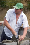 Bricklayer at work stock photography