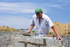 Bricklayer at work stock image