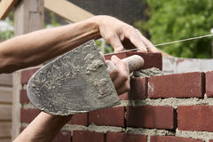 Bricklayer at work Stock Photos