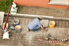 Bricklayer at work laying stone blocks. Stock Images