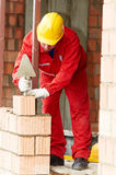 Bricklayer at work with red brick. Bricklaying construction work. bricklayer builder working with red brick Stock Photo