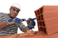 Bricklayer at work Stock Photo