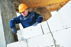 Bricklayer at work with silicate brick Stock Photography