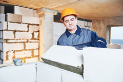 Bricklayer at work with silicate brick Royalty Free Stock Images