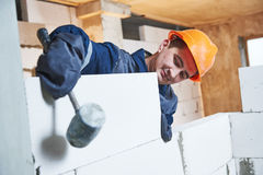 Bricklayer at work with silicate brick Stock Images