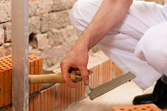 Bricklayer working on construction site Stock Photos