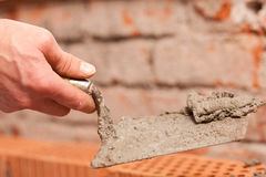 Bricklayer working on construction site Royalty Free Stock Photos